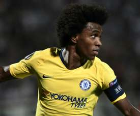 Willian celebrates scoring the only goal of the game in Greece. AFP