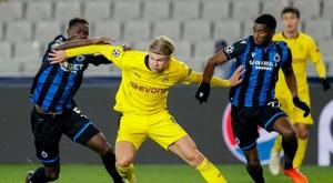 Borussia Dortmunds Erling Braut Haaland challenges Odilon Kossounou and Clinton Mata. AFP