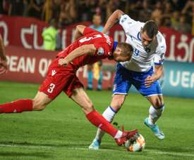 Belotti brace against 10-man Armenia extends Italy's perfect start. AFP