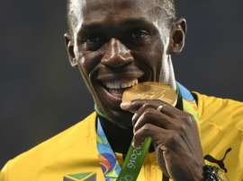 Bolt to announce football signing. AFP