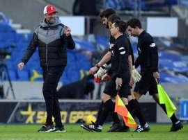 Liverpool boss Jurgen Klopp (left) was left frustrated by the fuxture schedule. AFP