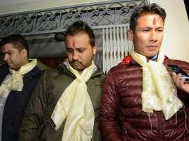 Nepalese footballers Sagar Thapa (R), Anjam KC (C) and Bikash Singh Chhetri (L) talk with the media outside a special court in Kathmandu on November 10, 2015