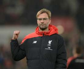 Liverpools manager Jurgen Klopp gestures during the warm up ahead of the English League Cup semi-final first leg football match at Britannia Stadium in Stoke-on-Trent, central England, on January 5, 2016