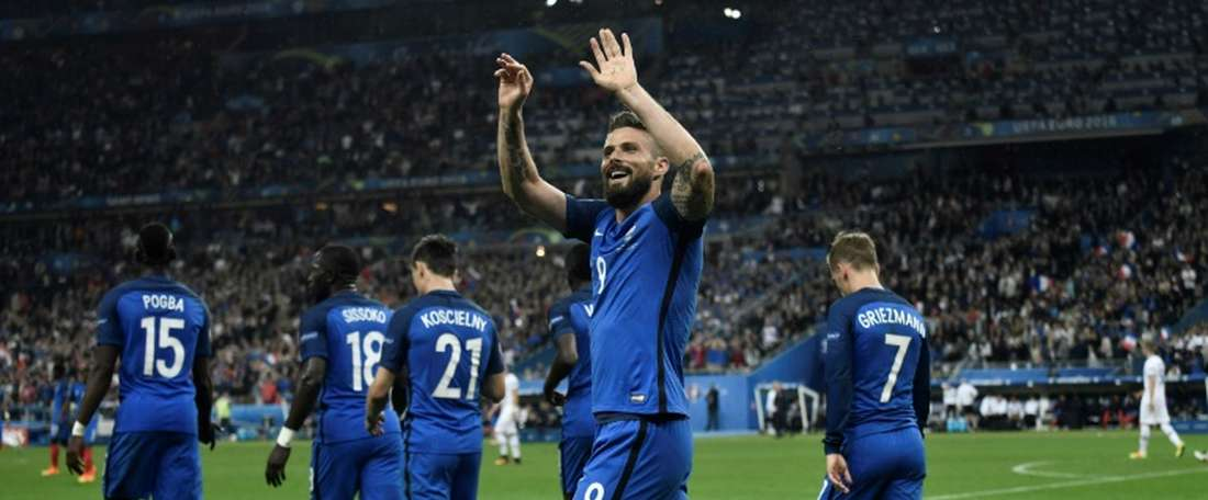Frances forward Olivier Giroud celebrates after scoring another goal during the Euro 2016 quarter-final football match between France and Iceland at the Stade de France in Saint-Denis, near Paris, on July 3, 2016