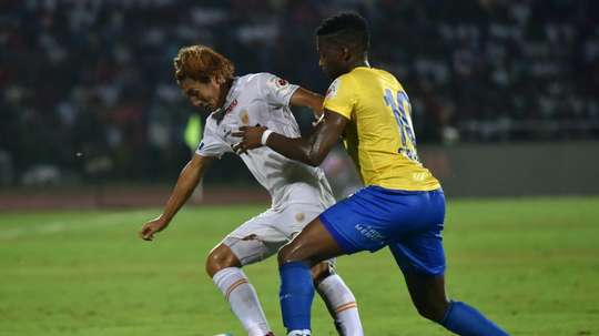 Kerala Blasters FCs forward Antonio German (R) challenges Northeast United FCs midfielder Katsumi Yusa for the ball during the Indian Super League football match between Northeast United FC and Kerala Blasters FC