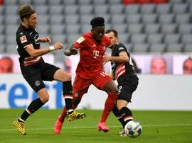 'Road Runner' Davies dazzles as Flick betters Guardiola's Bayern record. AFP