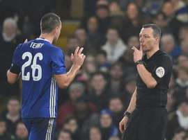 Chelsea defender John Terry (L) reacts just before Kevin Friend shows him a red card. AFP