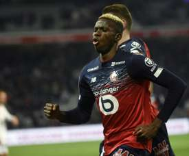 Lille up to third, Garcia's Lyon rout nine-man Nimes
