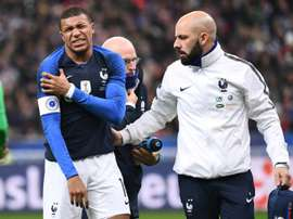 Mbappe left early. AFP
