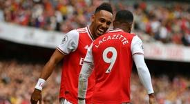 Lacazette (R) hopes Aubameyang stays at Arsenal. AFP