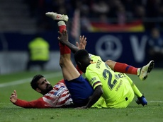 Atletico Madrid forward Diego Costa in a tangle with Barcelonas Samuel Umtiti. AFP