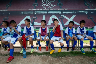 Children rest after a training session at the Guangzhou R&F Football Academy in Meizhou. AFP