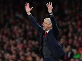 Wenger certainly believed that Arsenal should have been awarded a penalty. AFP