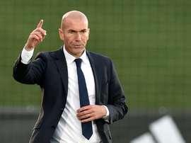 Former French football star and coach of Real Madrid Castilla Zinedine Zidane (R) gestures during the Spanish league second division football match Real Madrid Castilla vsTalavera de la Reina in Valdebebas on December 19, 2015