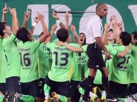 South Koreas Jeonbuk Hyundai Motors players celebrate a goal of midfielder Rodrigues Pereira. AFP