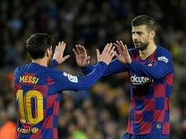Messi e Piqué alcançam marcas históricas na Champions League. AFP