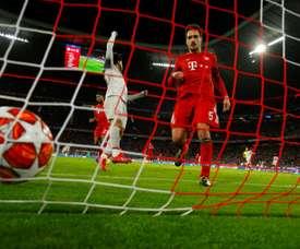 Hummels (r) could return to Borussia Dortmund this summer. AFP