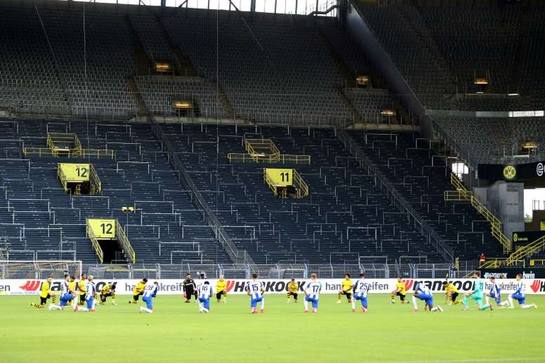 Borussia Dortmund and Hertha berlin players took a knee in solidarity. AFP