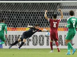 Qatars goalkeeper Muhannad Naim (C) tries to save a shot during their AFC U23 Championship 3rd place football match between Qatar and Iraq in Doha on January 29, 2016