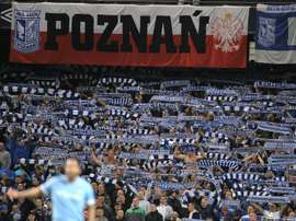 Lech Poznan fans cheer their team during the UEFA Europa League group A football match against Manchester City at The City of Manchester stadium, Manchester, England on October 21, 2010