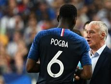 Dream on, France coach Didier Deschamps tells Juventus fans of signing Paul Pogba. AFP