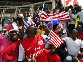 A Liberian supporter blows a vuvuzela horn during the 2014 FIFA World Cup qualifying football match Liberia vs Senegal on June 16, 2013 at the Samuel K. Doe Sports Complex in Monrovia