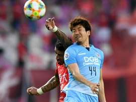 Paulinho rises to beat Tsubasa. AFP