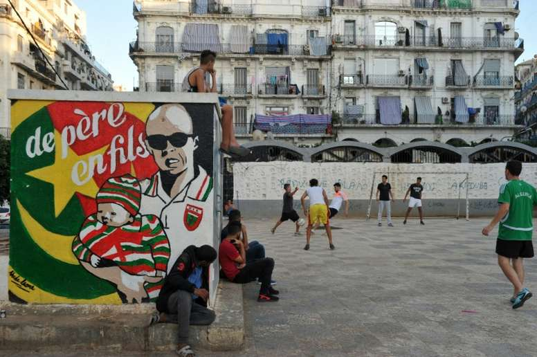 Algerians play football in Algiers Bab el-Oued neighbourhood, which is historically known to be a predominantly pro-Mouloudia Club Alger (MCA) area