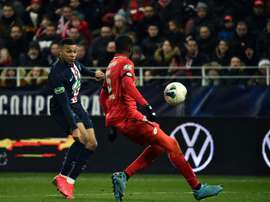 Mbappe (L) and PSG cruised to victory over Dijon in the French Cup QF. AFP