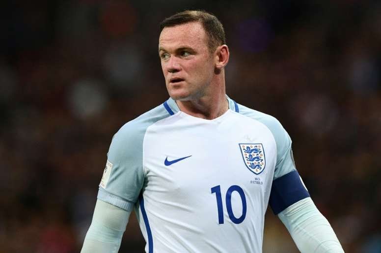 Rooney will not captain England, nor wear the number 10 shirt. AFP