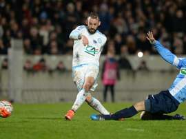 Marseilles forward Steven Fletcher (L) shoots the ball during the French Cup football match Trelissac vs Marseille on February 11, 2016 at the Chaban-Delmas stadium in Bordeaux, France