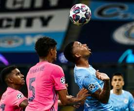 Raphael Varane's (L) two howlers gifted Man City a CL quarter-final place. AFP