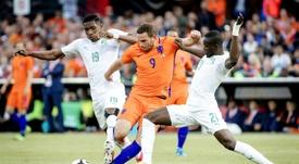 Netherlands Vincent Janssen (C) clashes with Simon Deli. AFP