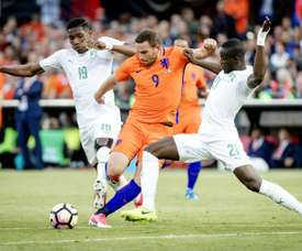 Netherlands Vincent Janssen (C) clashes with Simon Deli. AFP