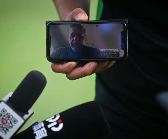 Beijing Guoan's coach is locked out of China and gave his press conference from France. AFP