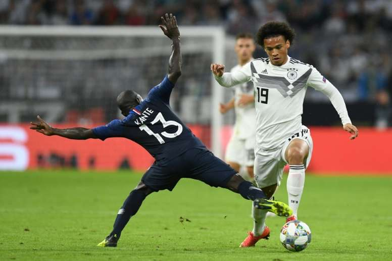 Leroy Sane hurdles a challenge from N'Golo Kante. AFP
