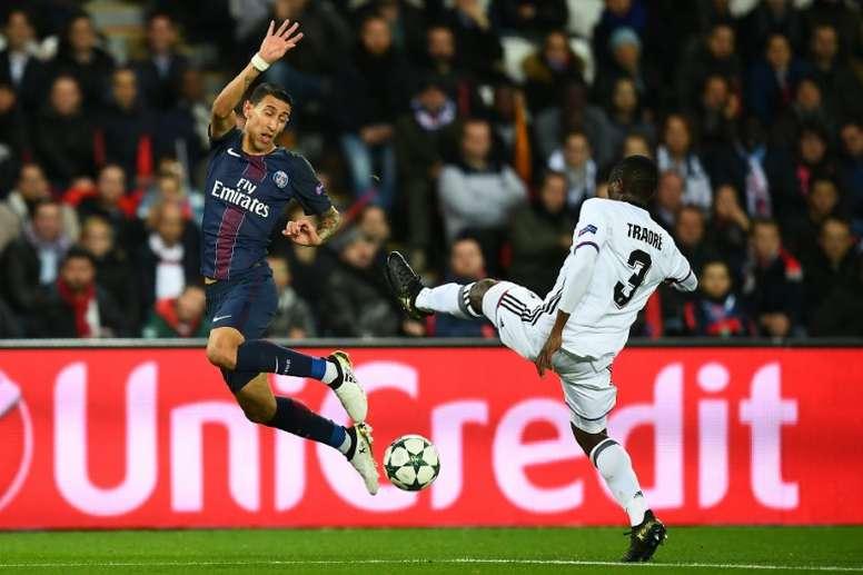 Paris Saint-Germain forward Angel Di Maria (L) challenges Basel defender Adama Traore. AFP