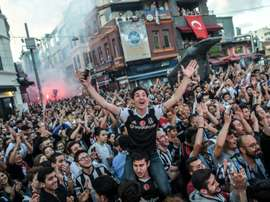 Besiktas fans celebrating the victory of the Turkish league. AFP