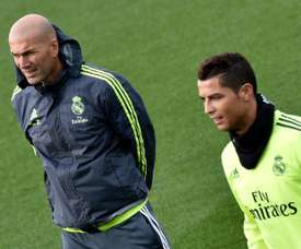 Real Madrid coach Zinedine Zidane (left) and forward Cristiano Ronaldo take part in a training session at the Valdebebas training ground in Madrid, on January 8, 2016