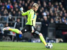Kasper Schmeichel passes the ball during the  match between FC Copenhagen and Leicester City. AFP