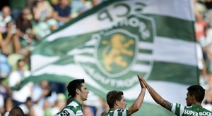 Sporting Lisbons players celebrate after scoring a goal during a Portuguese league match at the Jose Alvalade stadium in Lisbon, in May 2015