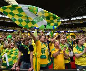 Norwich City fans celebrate after Norwich City won the English Championship play off final football match between Middlesbrough and Norwich City at Wembley Stadium in London on May 25, 2015