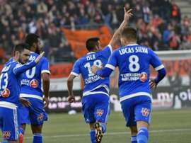 Marseilles midfielder Mauricio Anibal Isla (C) celebrates with teammates after scoring a goal during a French L1 football match against Lorient on March 12, 2016 at the Moustoir stadium in Lorient, western France