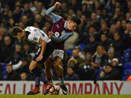 Grealish was floored by a pitch invader. AFP