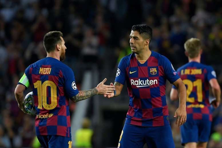 Messi and Suarez have scored 800 goals for Barca between them. AFP