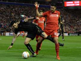 Liverpools German midfielder Emre Can (R) vies for the ball with Rubin Kazans Bulgarian midfielder Blagoy Georgiev (L) during a UEFA Europa League group B football match in Liverpool, England, on October 22, 2015
