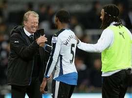 Newcastle Uniteds head coach Steve McClaren (L) congratulates Georginio Wijnaldum (C) following the match between Newcastle United and Liverpool at St James Park on December 6, 2015