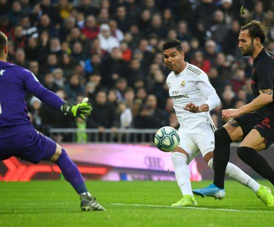 Madrid go top after scrappy win over Sevilla. AFP