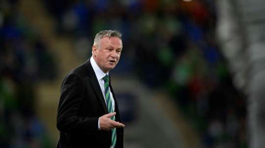 O'Neill will stick with Northern Ireland if they make Euro play-offs. AFP