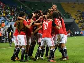 Egypts players celebrate a goal on January 21, 2017